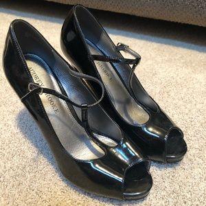 Black heels - think they've never been worn